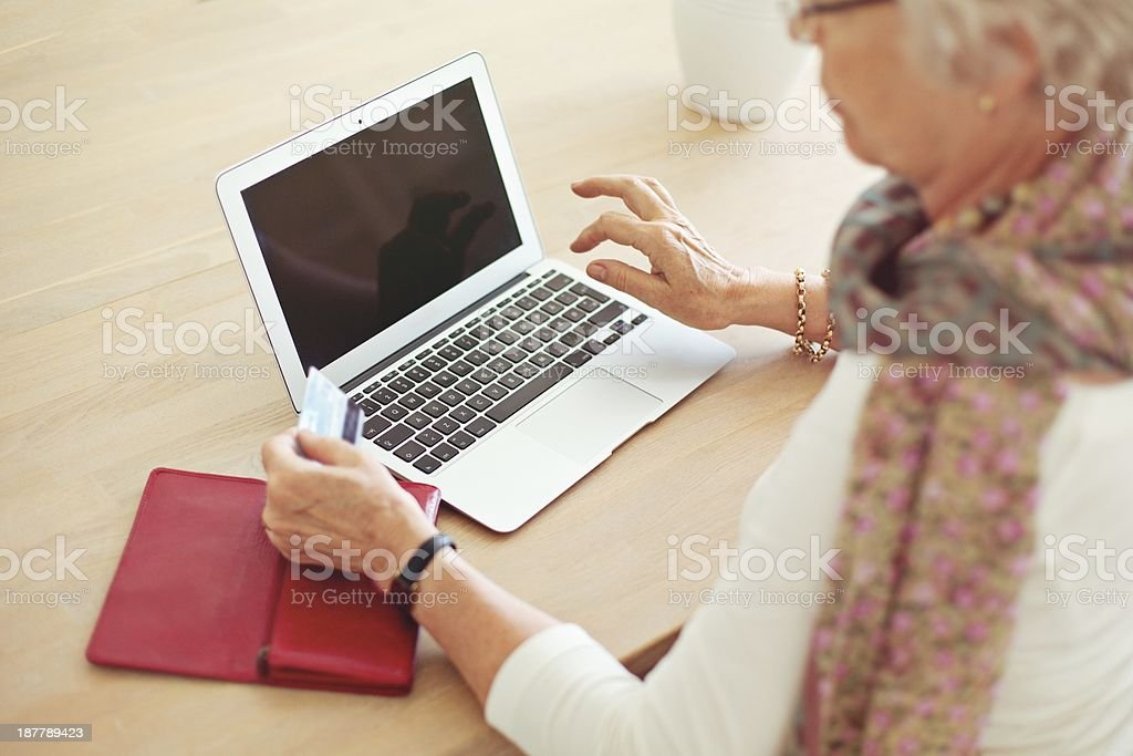 Old Woman Using Laptop with Blank Screen stock photo