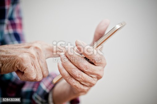 istock Old woman using mobile 528430066