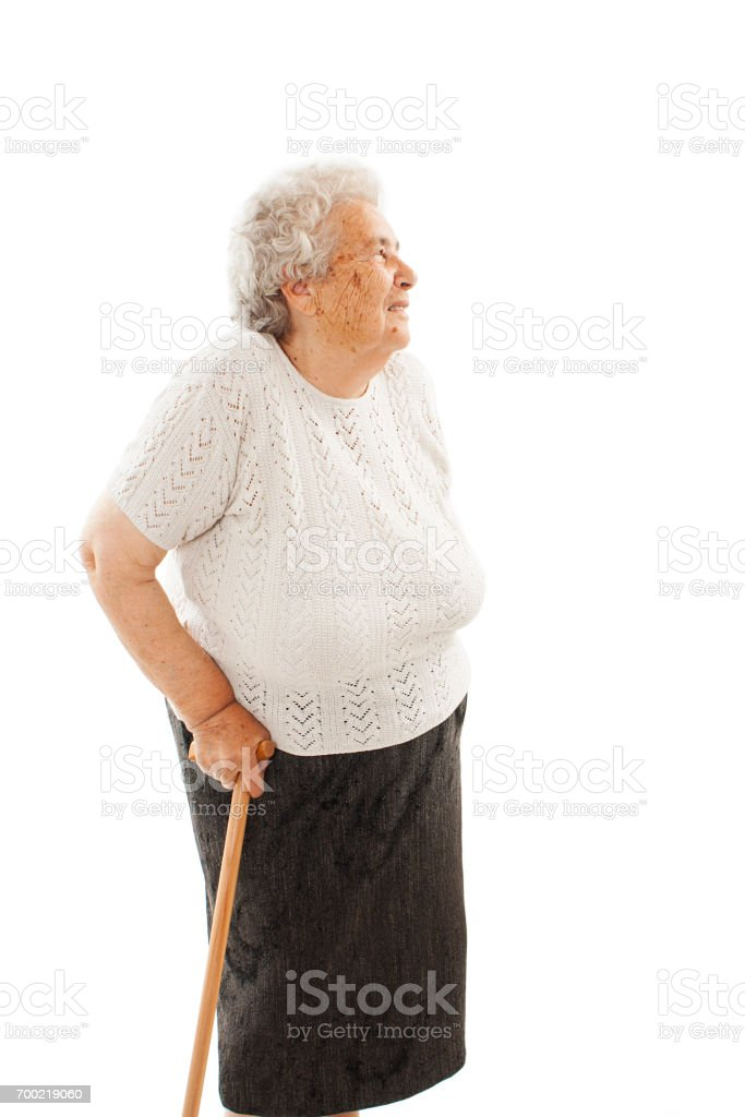 Old woman with a cane looking up stock photo
