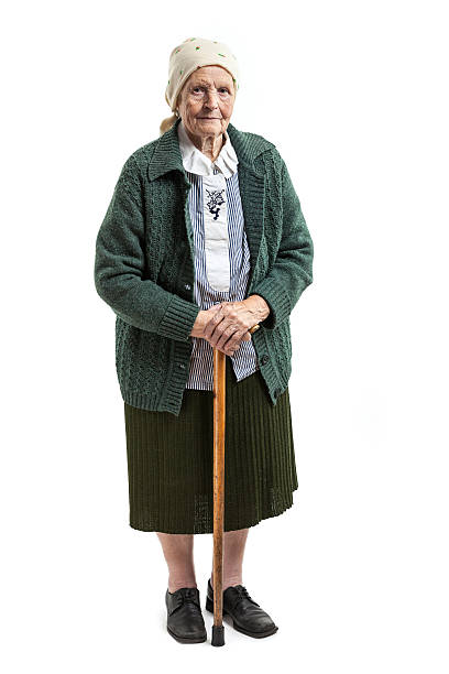 Old woman with a cane over white stock photo
