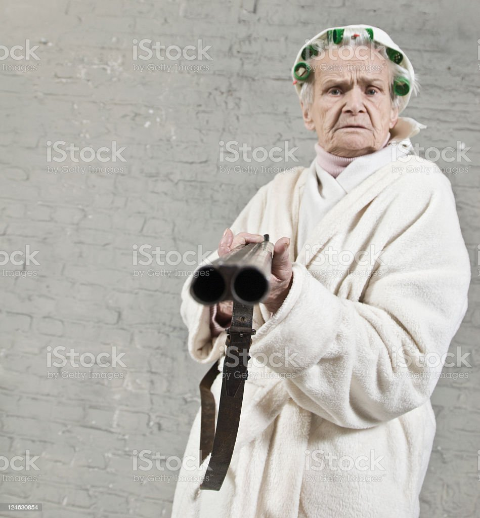 Old woman with a shotgun royalty-free stock photo