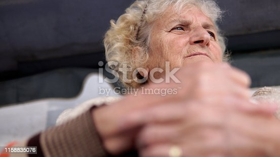 698466046istockphoto Old woman with hand pain or stiffness. Acute pain in a woman wrist. Female holding hand to spot points of ache. Concept indicating location of the pain 1158835076