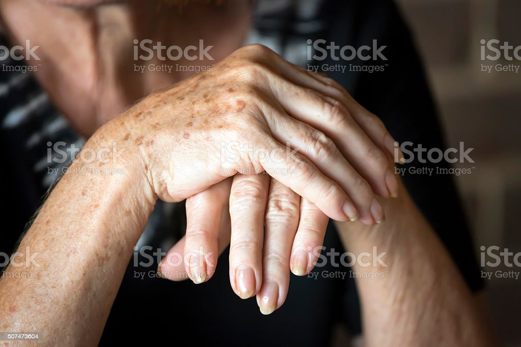 Old woman's hands, copy space stock photo