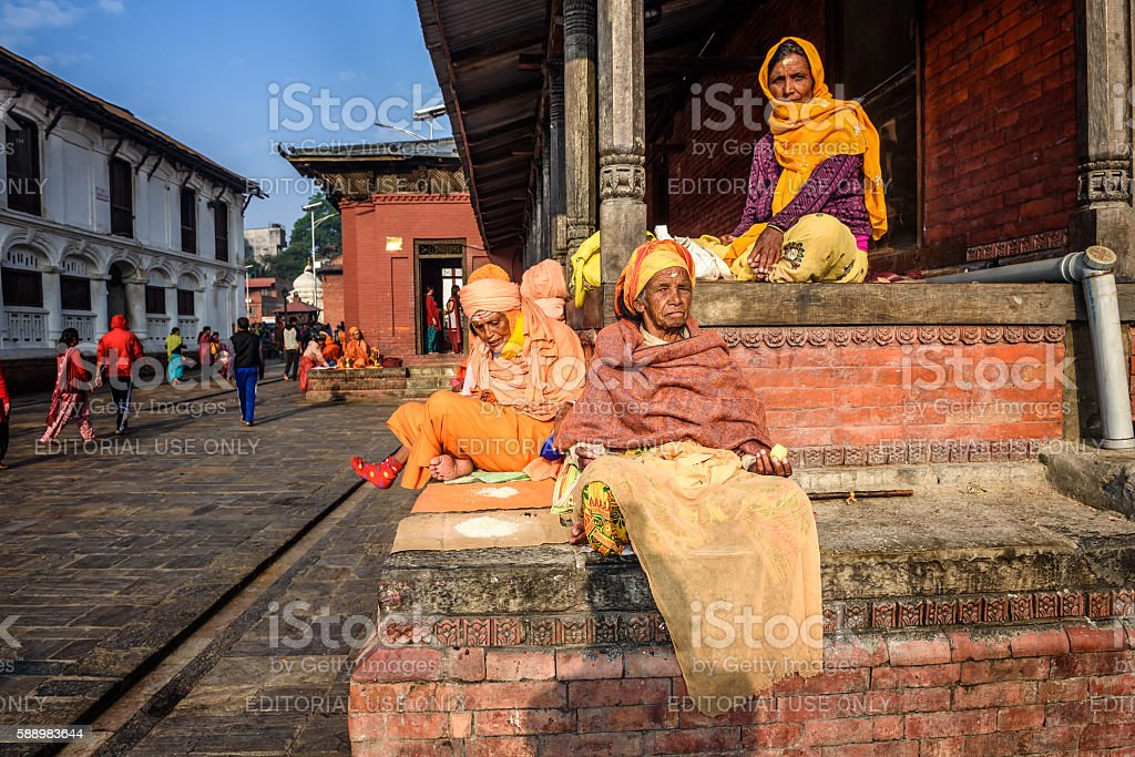 Old women begging at Pashupatinath Temple complex in Kathmandu, Nepal stock photo