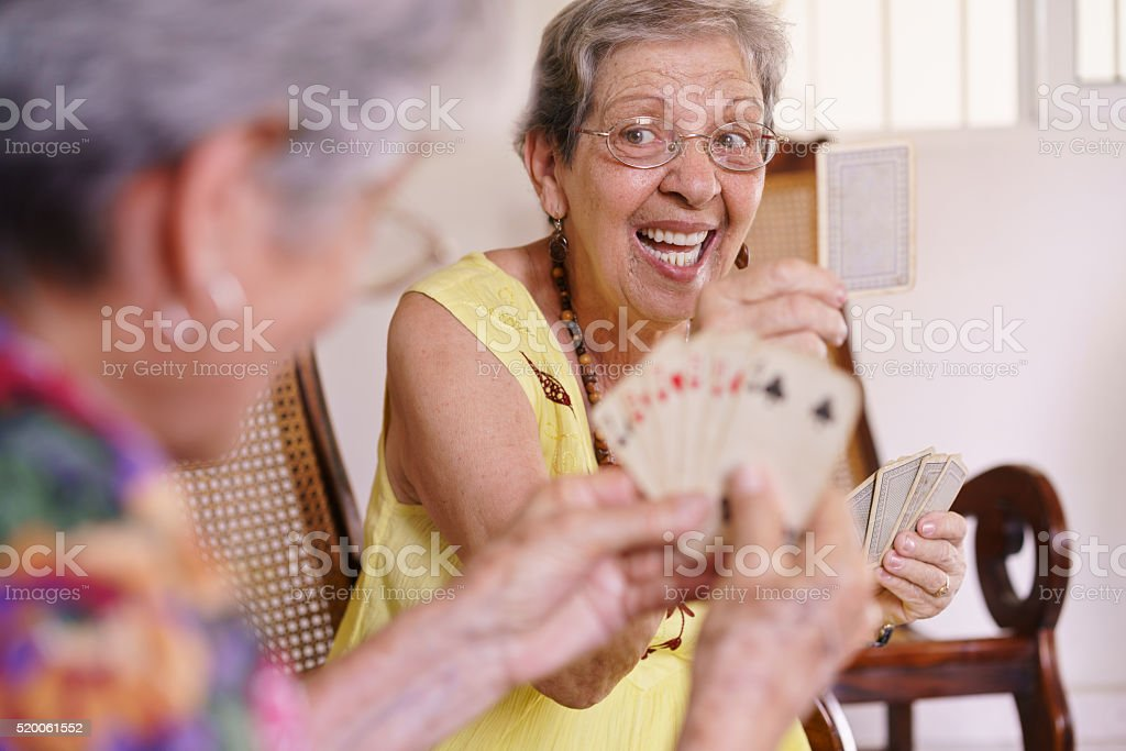 Old Women Enjoy Playing Card Game In Hospice stock photo