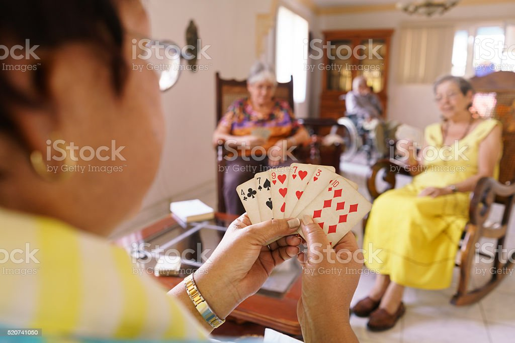 Old Women Have Fun Playing Card Game In Hospice stock photo