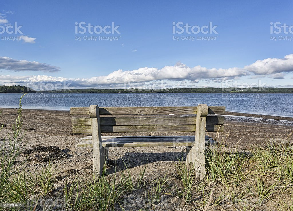 Old wood and concrete bench facing Penobscot River, Maine stock photo