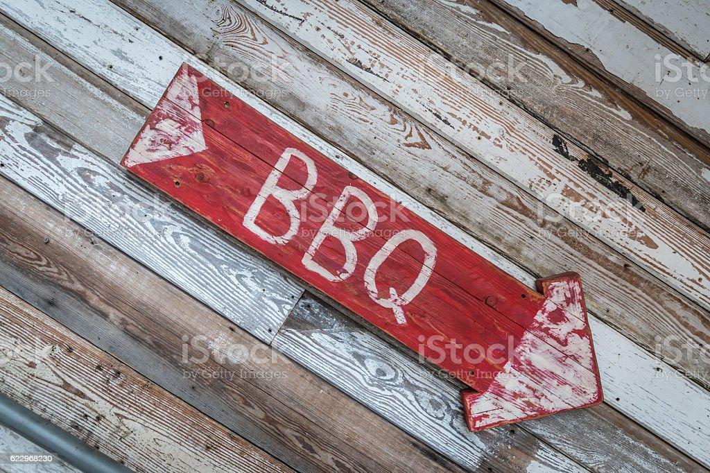 Old Wood Arrow BBQ Sign stock photo