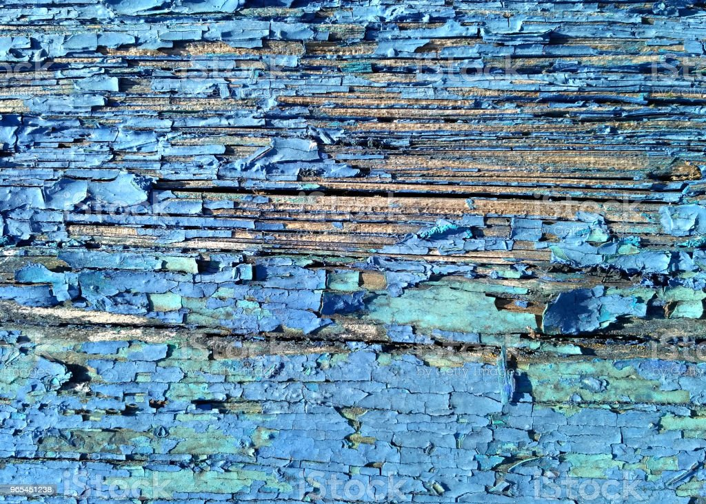 Old wood background close up. Aged painted cracked board with blue color peeling zbiór zdjęć royalty-free
