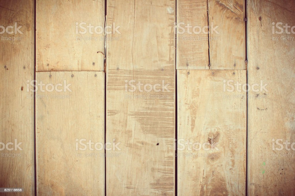 wooden background of weathered distressed rustic wood with faded...