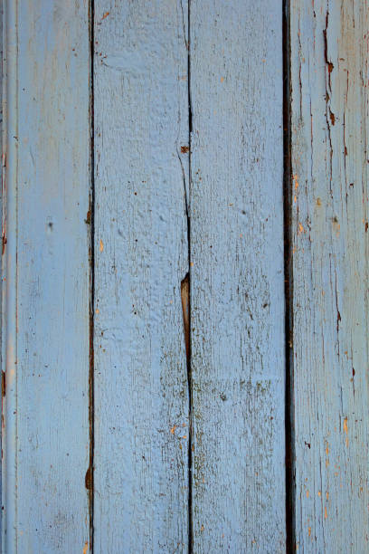 old wood board painted blue - palisade boundary stock photos and pictures