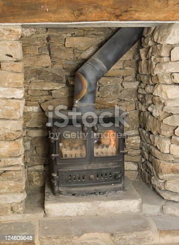 Wood burning stove fire burning in a old cottage.