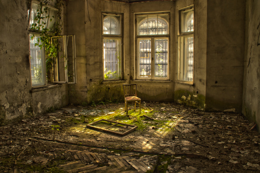 Old wood chair in an abandoned and dilapidated house