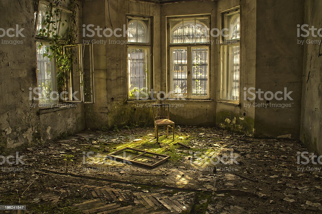 Old wood chair in an abandoned and dilapidated house stock photo