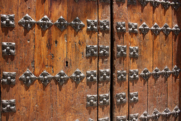 old wood door with iron nails stock photo