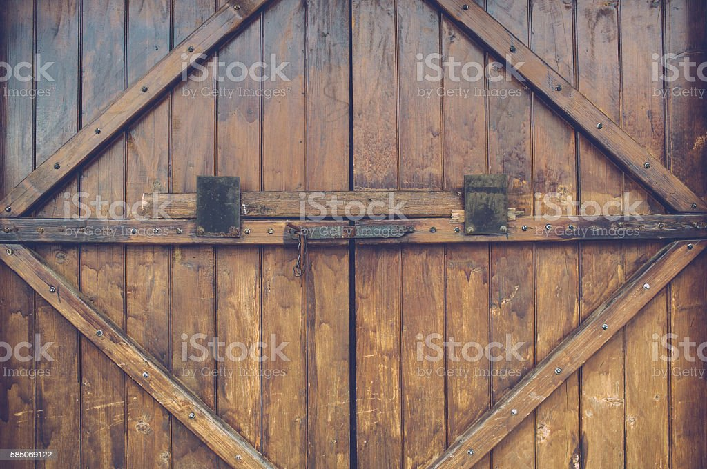 Old wood door with metal handle stock photo