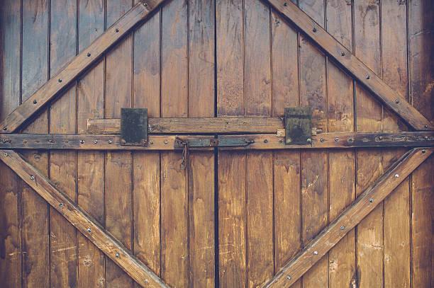Old wood door with metal handle stock photo