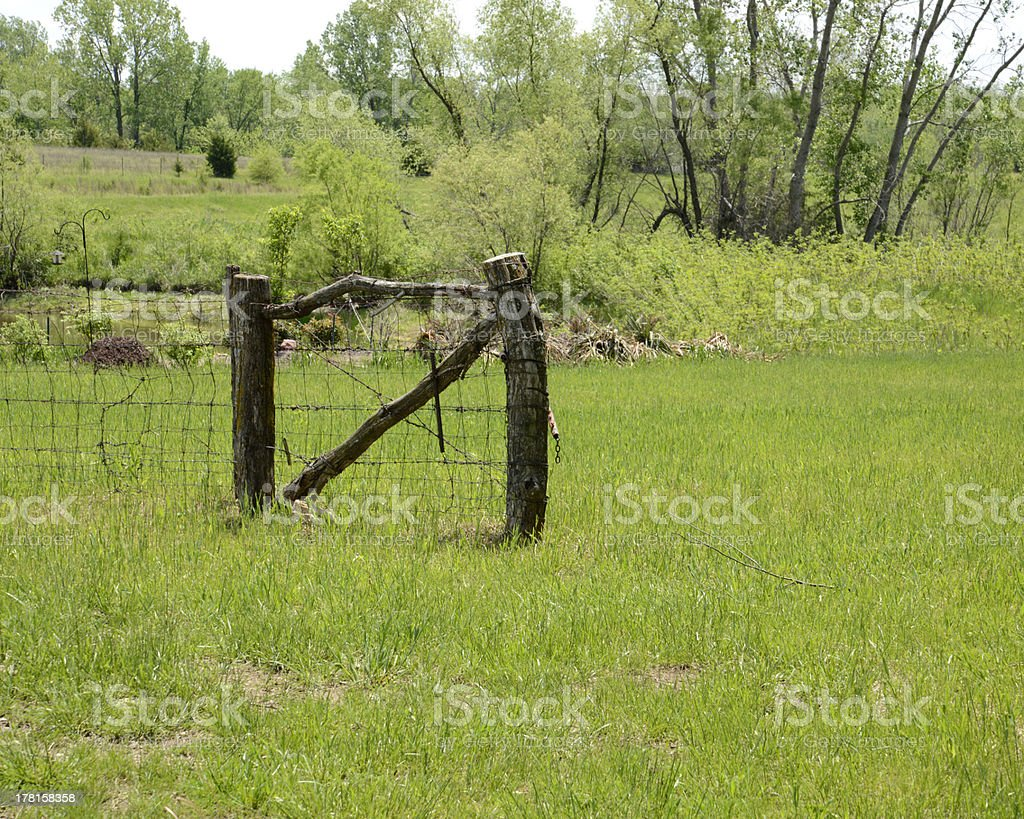 old wood gate in a field royalty-free stock photo