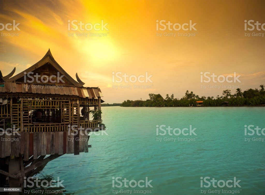 Old Wood House in Bang Pa Kong River of Thailand, Twilight sky. stock photo