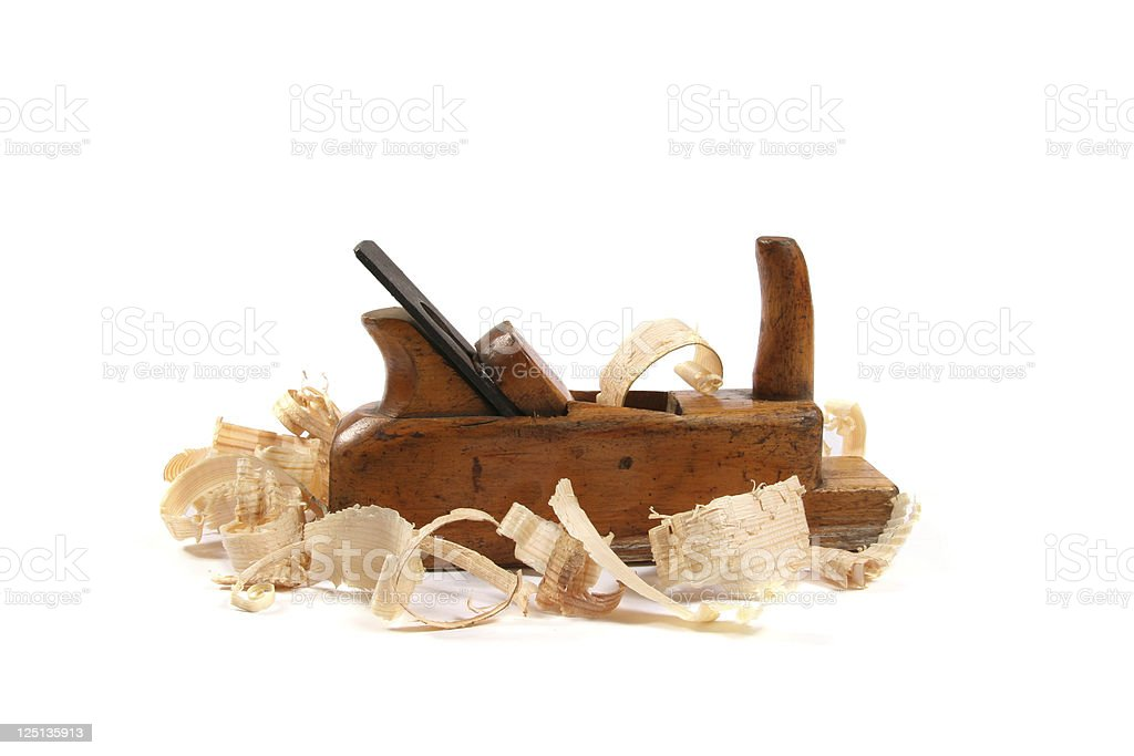 old wood plane with scobs stock photo