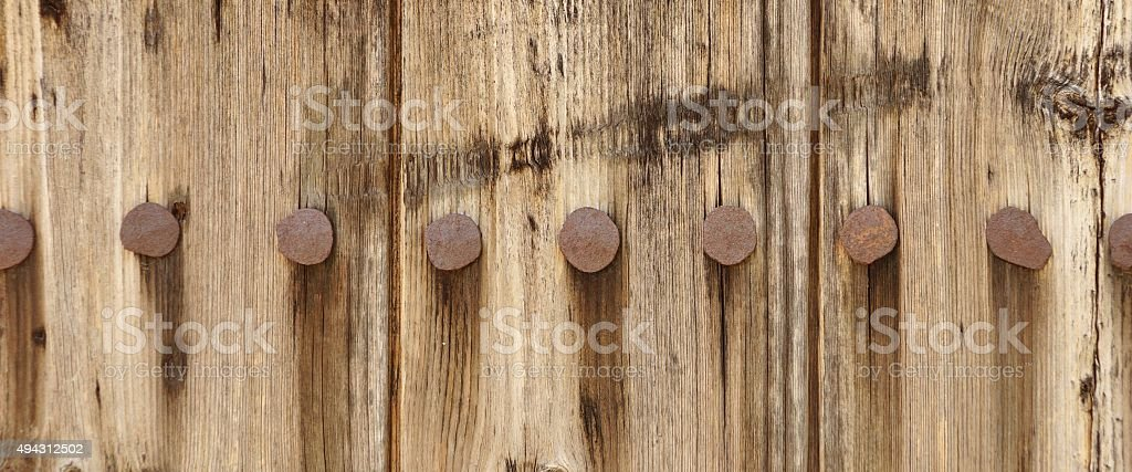 Old Wood Plank Panel With Forged Rusty Iron Nails Texture Royalty Free Stock Photo