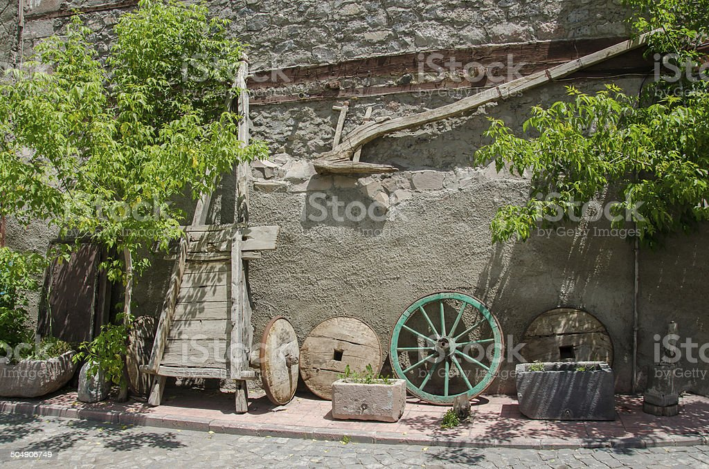 Old wood plow, tumbrel and wheels stock photo