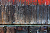 Old wood storage barn warehouse exterior wood siding grunge texture background
