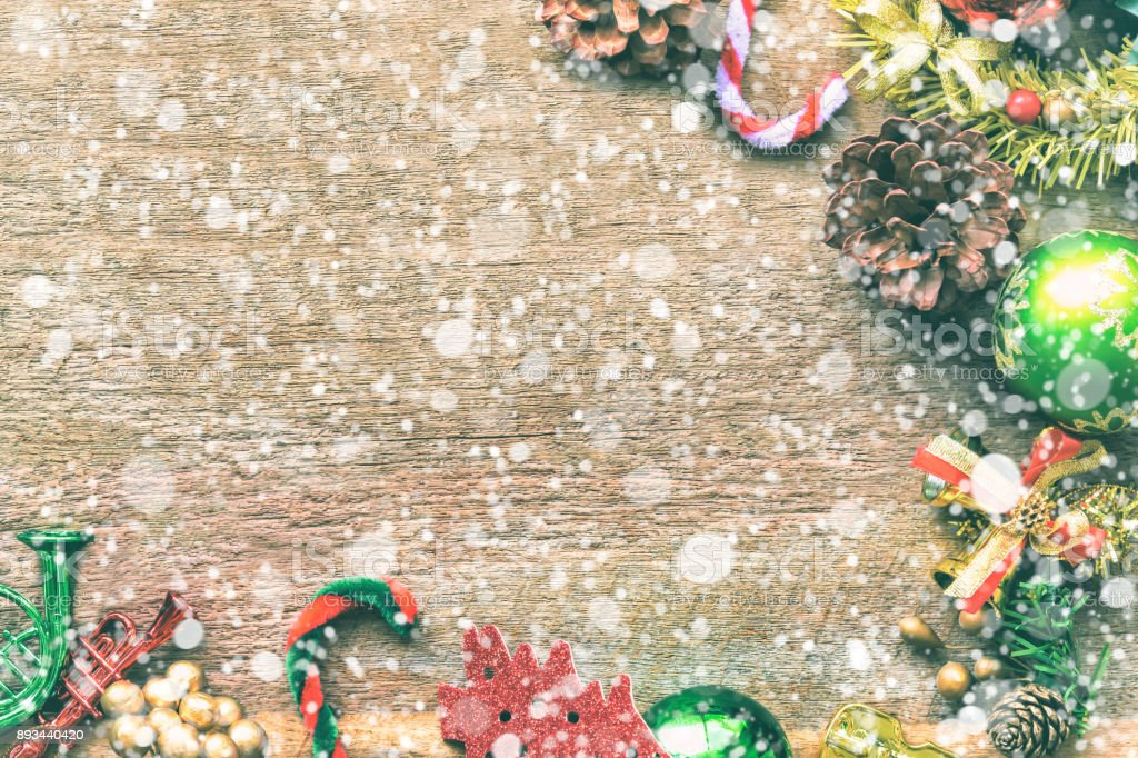 Old Wood Table Decorate With Christmas Theme And Snowfall Effect In