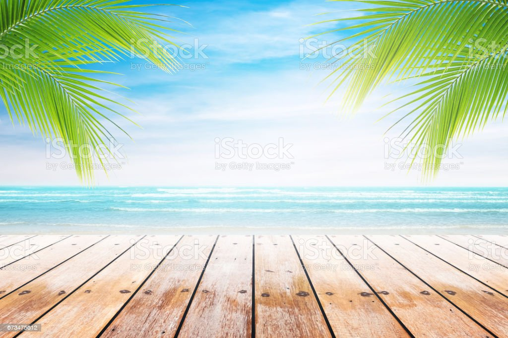 old wood table top on blurred beach background. - foto stock