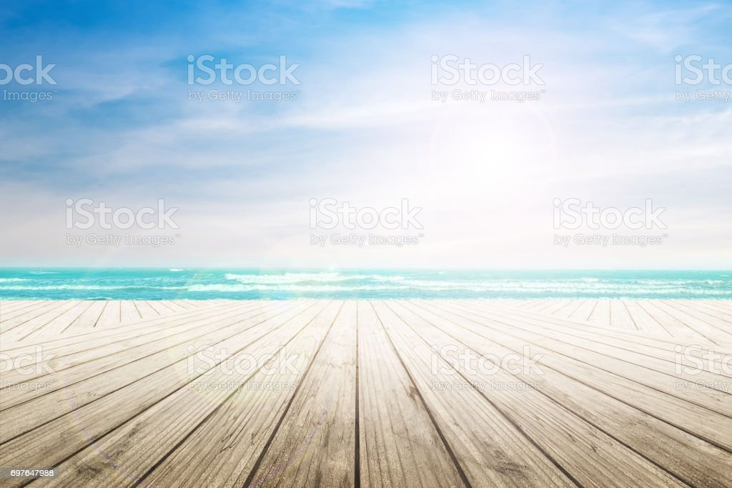 old wood table top on blurred beach background. stock photo