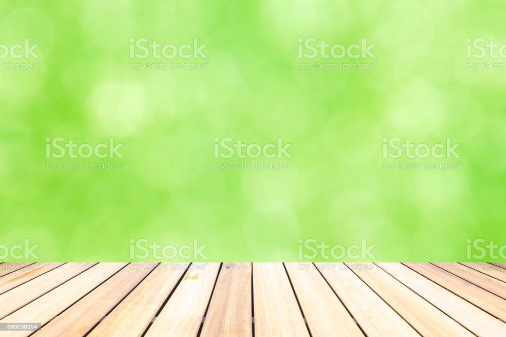 Old Wood table top on  green bokeh abstract background ロイヤリティフリーストックフォト