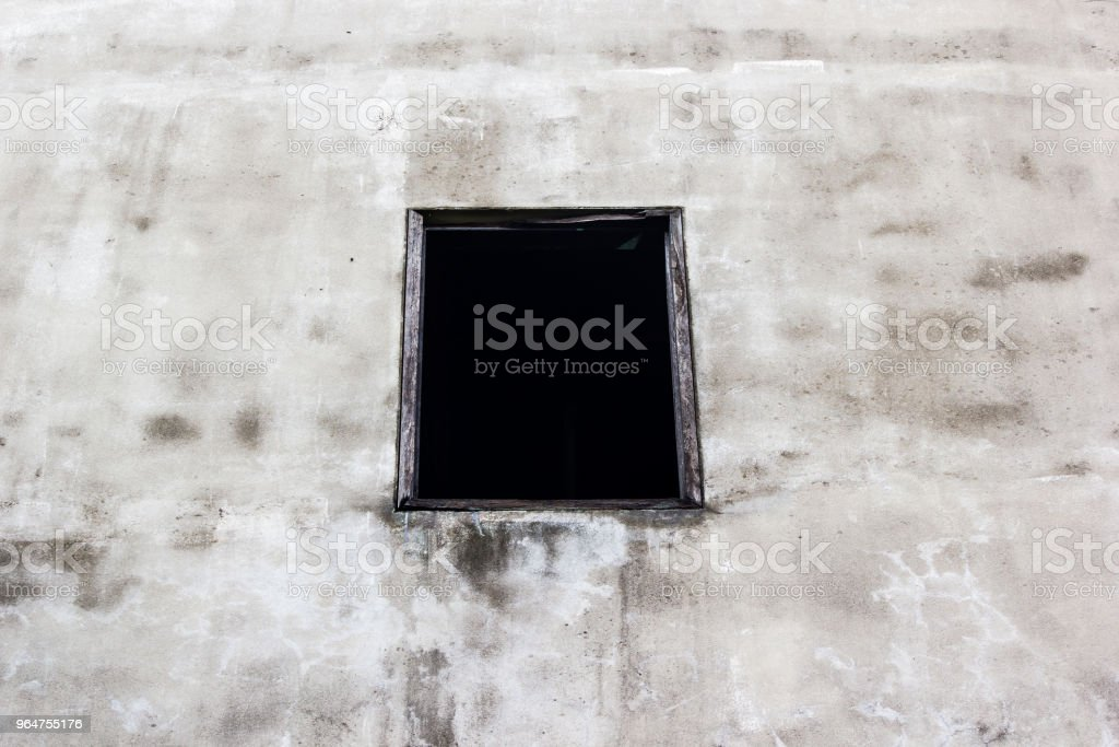 Old wood window on the concrete wall background. royalty-free stock photo