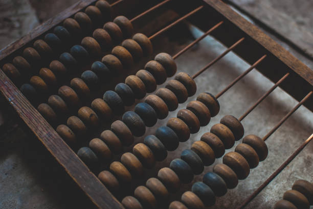 Old wooden abacus laying on dusty floor of storage. - foto stock