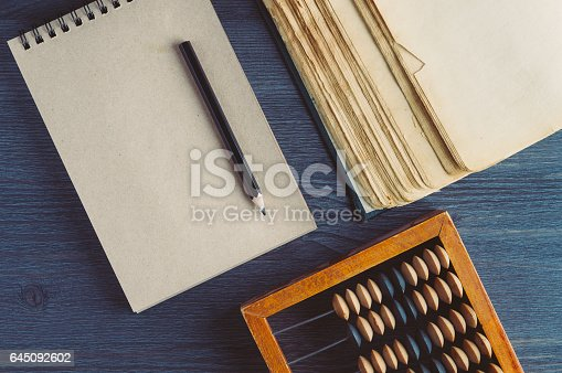 istock Old wooden abacus on dark background. The concept of bookkeeping, business or saving money 645092602