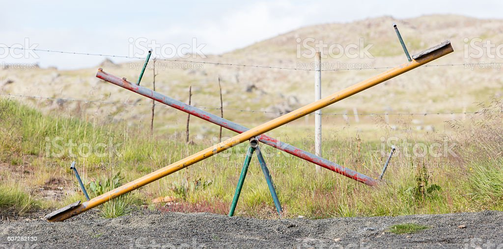 Old wooden and steel seesaw - foto de stock