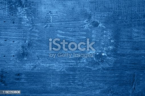 istock Old wooden background in trendy blue color of the year 2020. 1192250606
