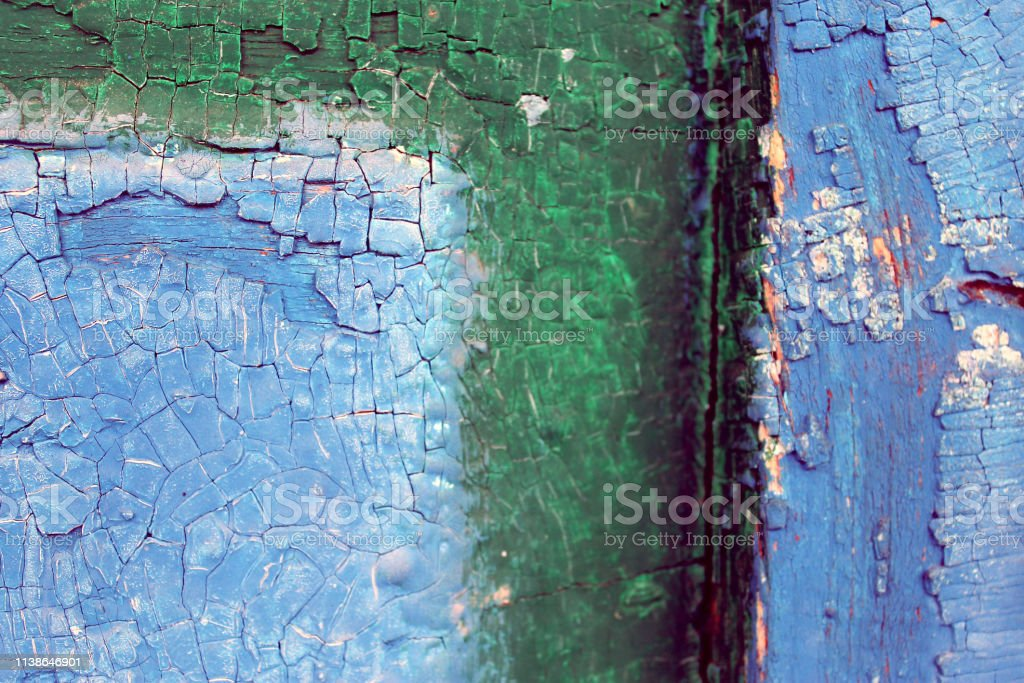 old blue board with cracked paint, vintage wood background, grunge...