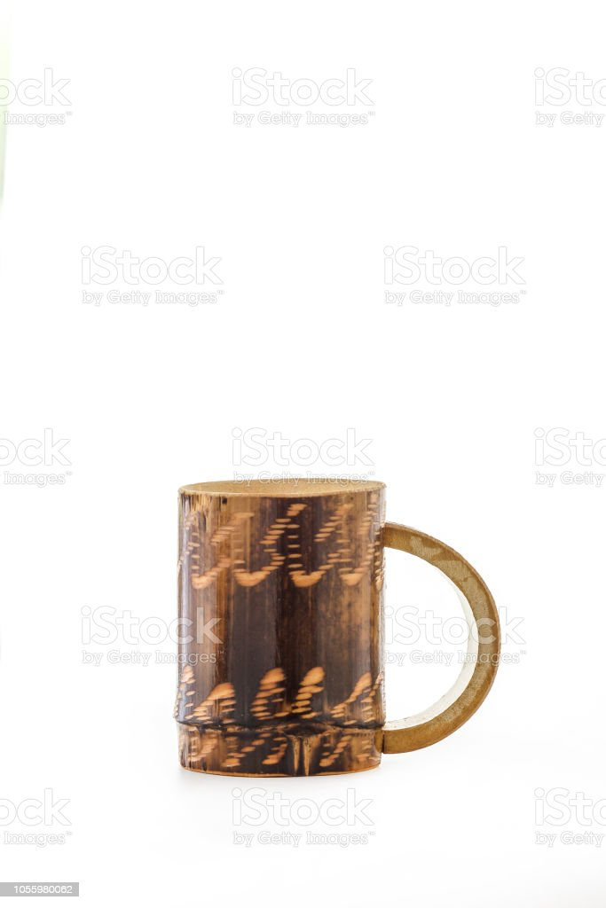 Old wooden bamboo cup isolated on white background stock photo