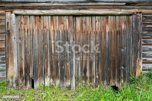 istock Old wooden barn gate closed. 545985888