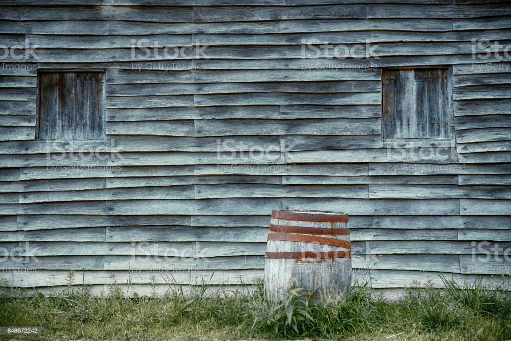 old wooden barrel on the background of a wooden wall stock photo