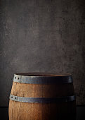 old wooden barrel on grey background, copy space