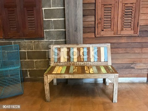 istock Old wooden bench in front of wood house 904519228