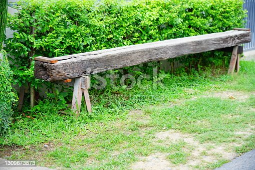 Old wooden bench in garden from Wooden pole.