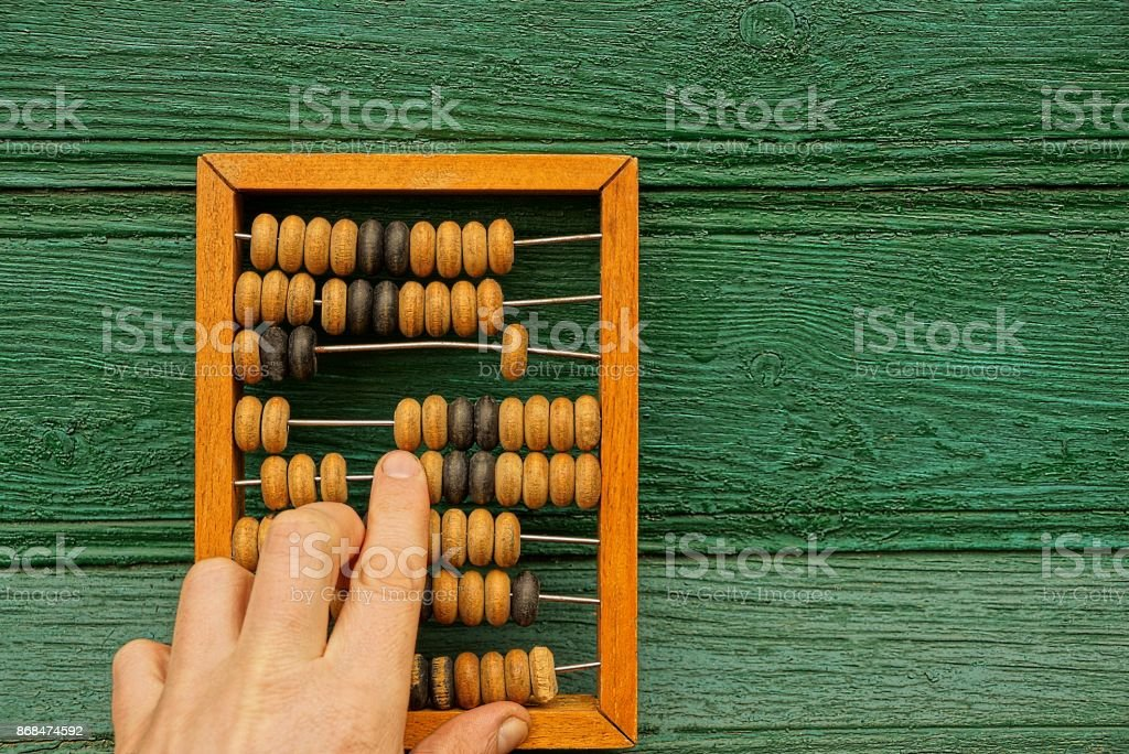 Old wooden bills and a hand with a finger stock photo