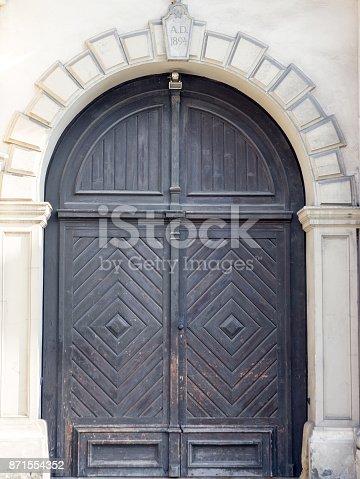 istock Old wooden black door close-up. 871554352