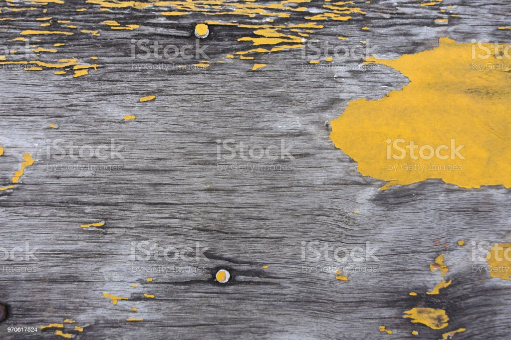 Old wooden board texture with yellow paints are peeling stock photo