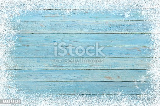 istock Old wooden board with snow flakes . Christmas background. Top view with copy space 888133434