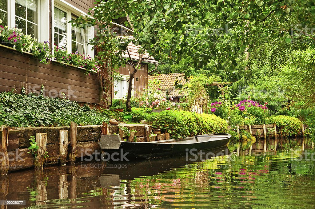 Old wooden boat on clear river in Spreewald/ Germany stock photo
