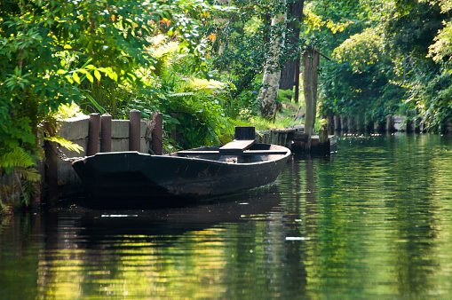 Old wooden boat on clear river in Spreewald/ Germany
