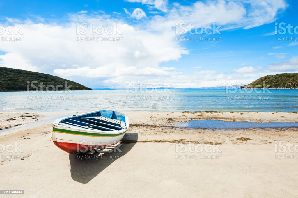 Old wooden boat on the coast of Titicaca lake royalty-free stock photo